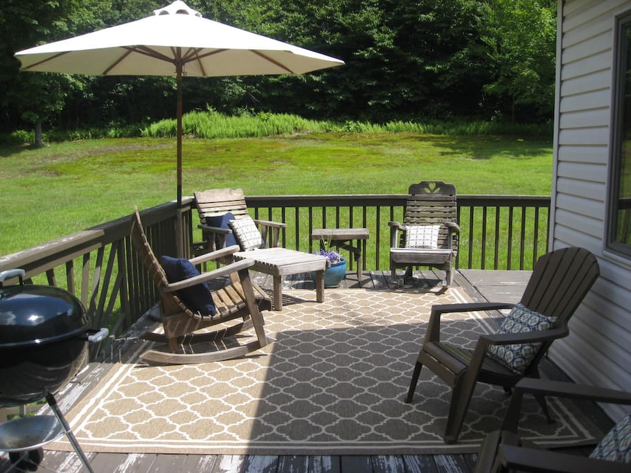 The private setting on the back porch makes for a great grill and relaxation area.