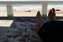 Relaxing in a comfortable lounge chair on the patio of Shores A'Swell and enjoying the beach scene!