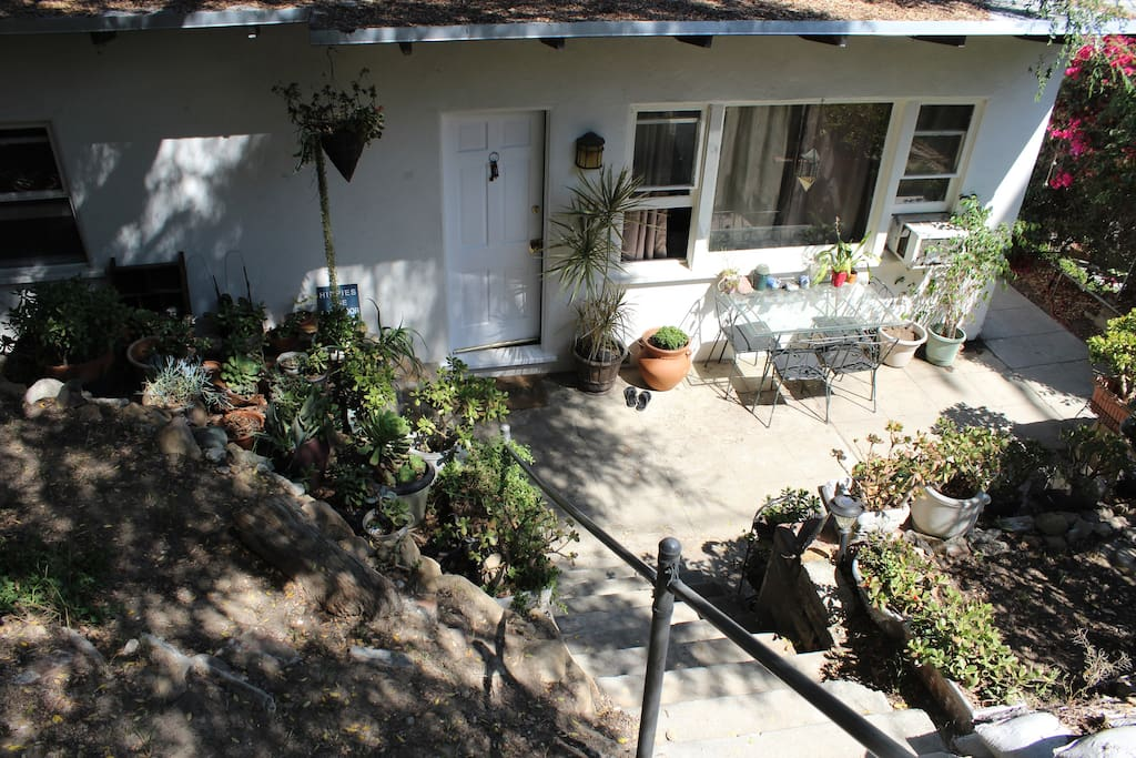 The entrance/ front yard and patio.