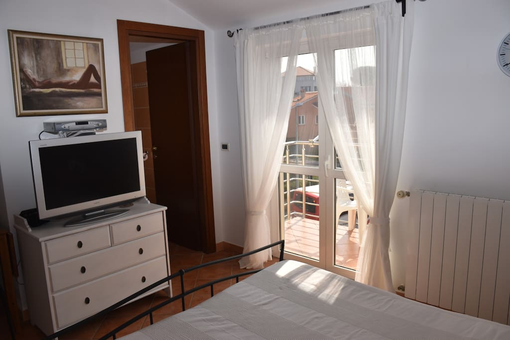Room with TV and balcony...