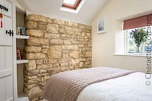 Beautiful exposed Cotswold stone wall