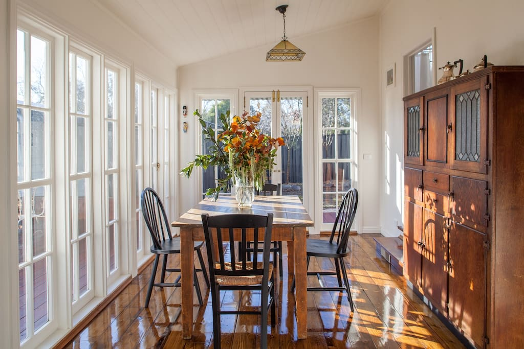 Lovely, light filled dining room with adjoining galley style kitchen