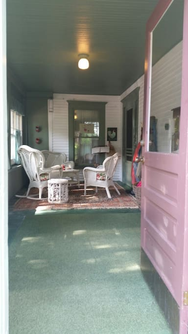 Enjoy the morning sun on this entry porch.  Room to store bicycles/gear