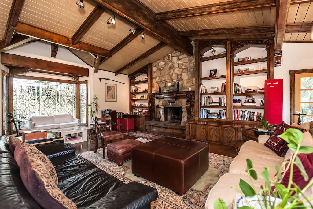 Living room w/ vaulted ceiling, gas fireplace, piano, stunning canyon views.