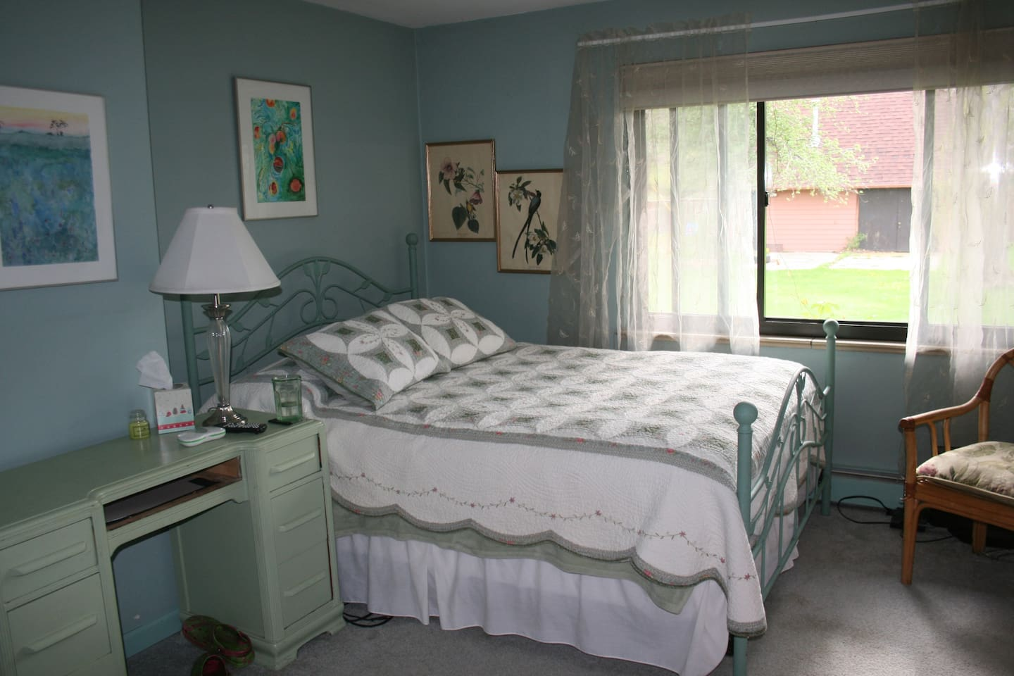 Queen bed, window overlooks the yard to the west.