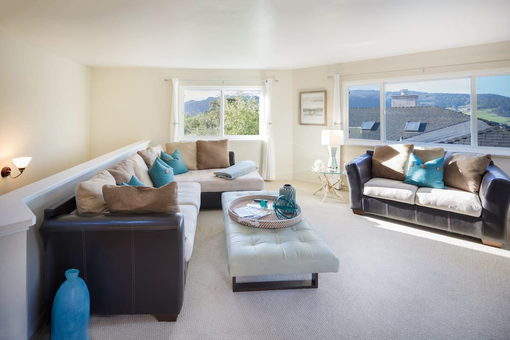 Large, cozy living area that easily seats six to spread out after a day of adventures!