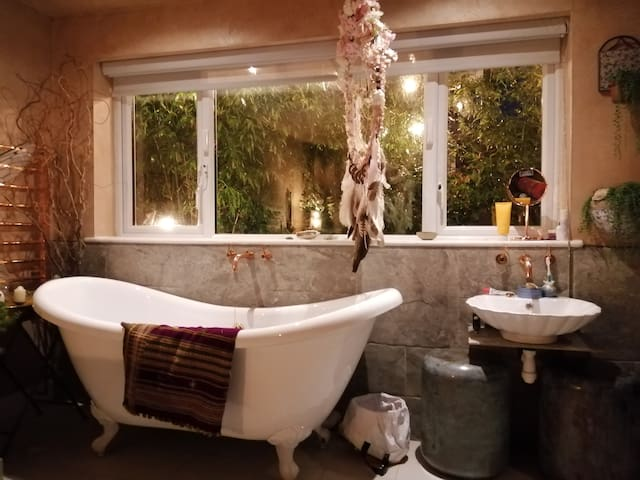 Garden Room with roll top bath on the ground floor