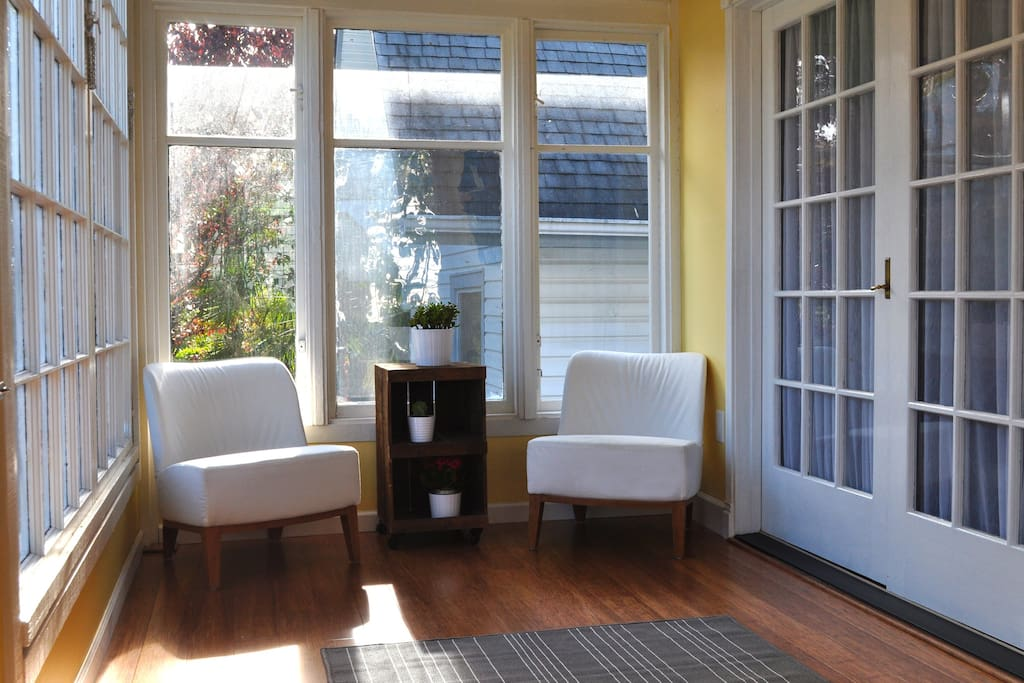 A bright sun room greets you when you walk into the cottage. It's a great place to relax and read.