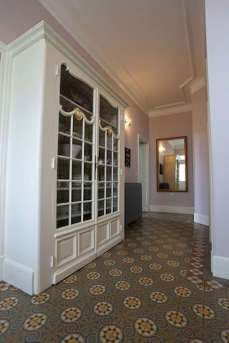 Entrance hall with original tiling and cabinet
