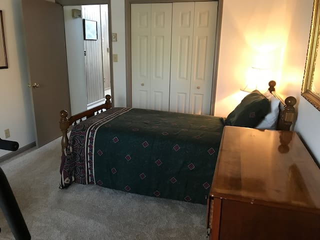 Bedroom downstairs with gym