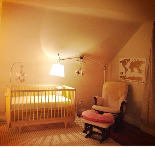 Nursery room also includes two futons (not pictured).