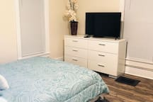 2nd floor master bedroom with queen size bed and tv