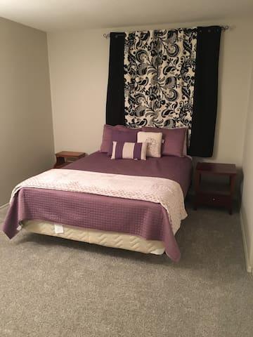 Guest bedroom with queen size mattress