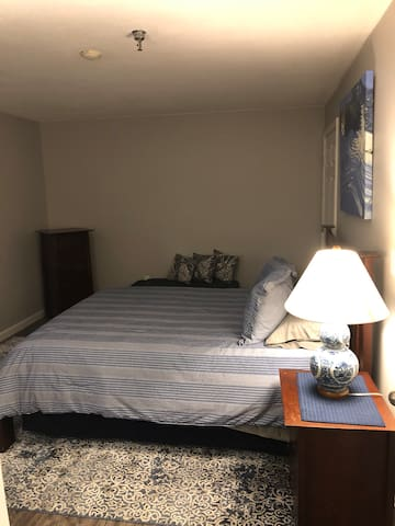 Queen size bed. Closet with hangers and bureau in the unit. Lights must be turned on manually, the light switch does not work.