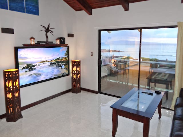 Living Room with 70-inch Large Screen TV, Ocean View