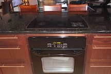 Kitchen counter has built-in Cooktop and Stove