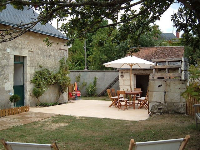Lovely private patio with table & chairs and garden area