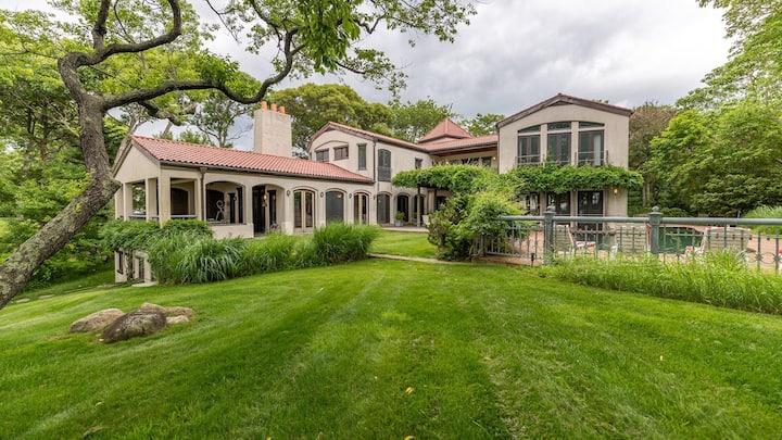New Listing: Elegant European Manor on Noyack Bay w/ Private Beach & Heated Wraparound Pool