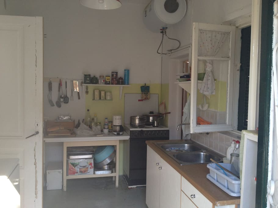 Full kitchen with refrigerator, sink, stove and pantry