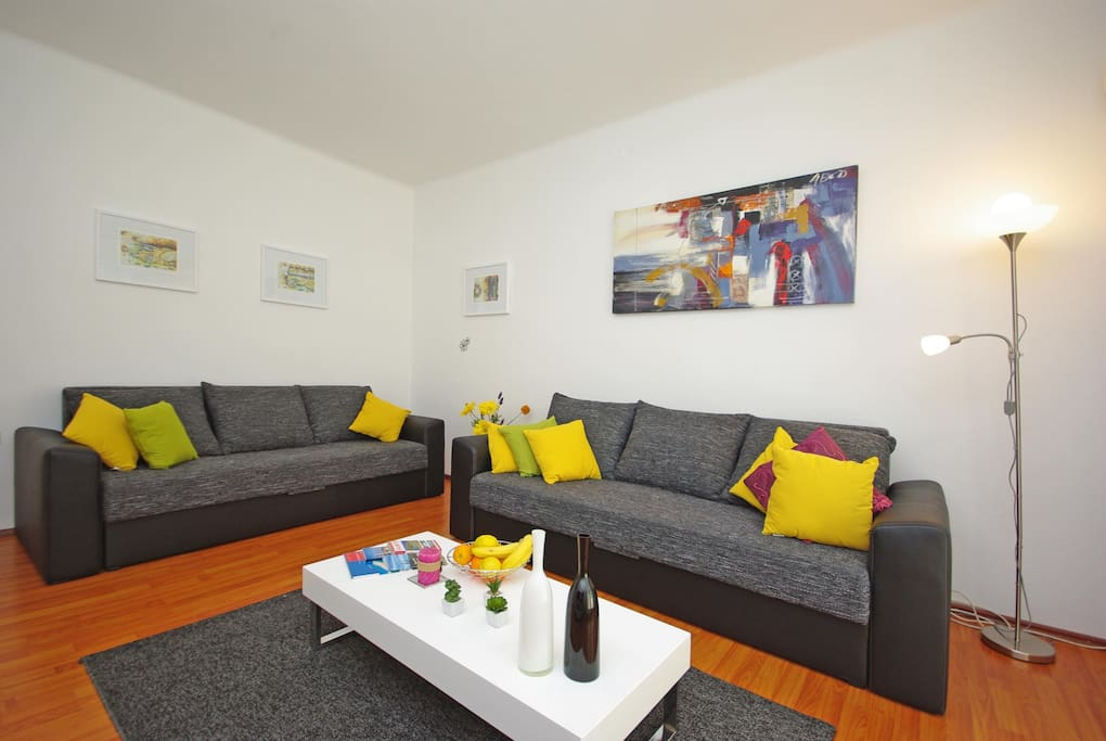 There are two sofas in the living room which can easily be pulled out into two beds for 4 people. There is also a TV, air conditioning and a sunny balcony where you can dry your clothes.
