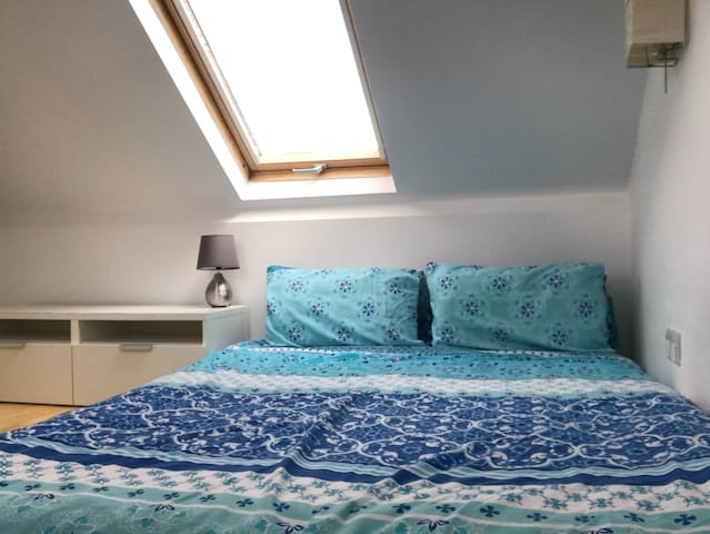 Bright cozy attic double bedroom