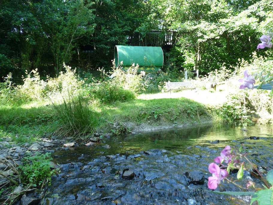 Enjoy the stream side camp fire. The whole acre site is all yours, no sharing, its peace and seclusion is uppermost!