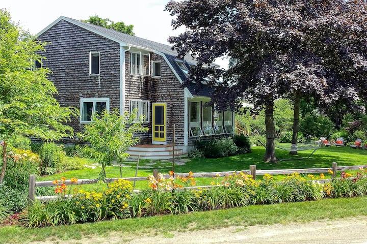 Classic coastal home near the beach w/ lush garden, game room & deck - dogs OK