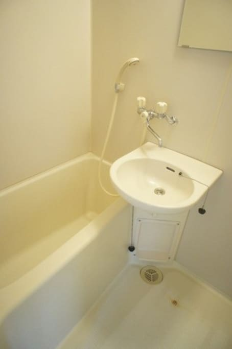 Bathtub with shower. Separate toilet.