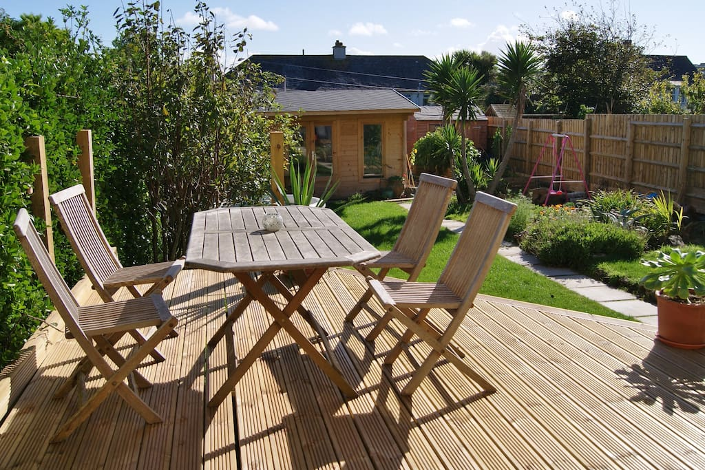 South facing sunny garden. Perfect for outside dining whilst the kids play on trampoline