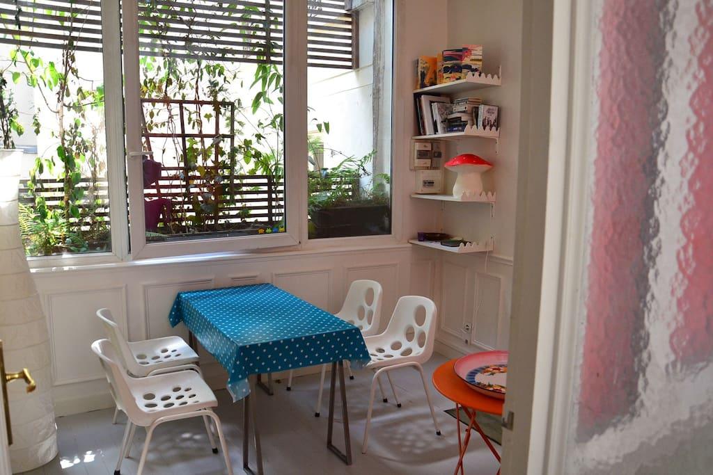 the luminous dining room with a green tiny garden balcony