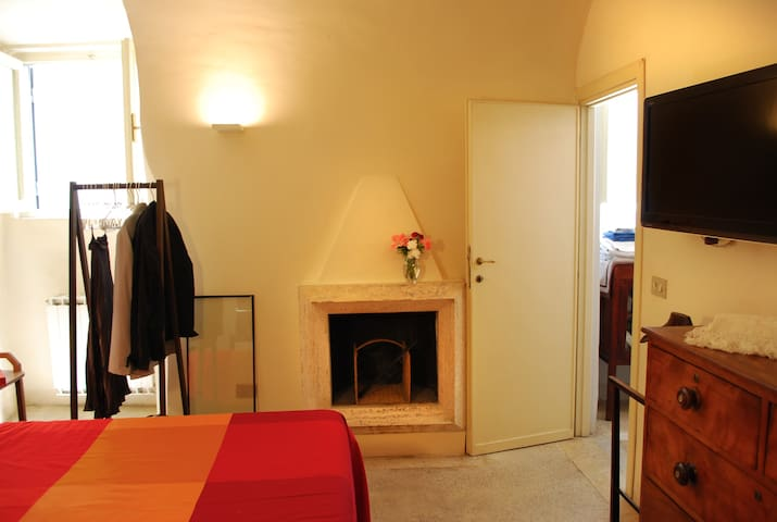 bedroom double bed + fireplace + A/C + Bathroom