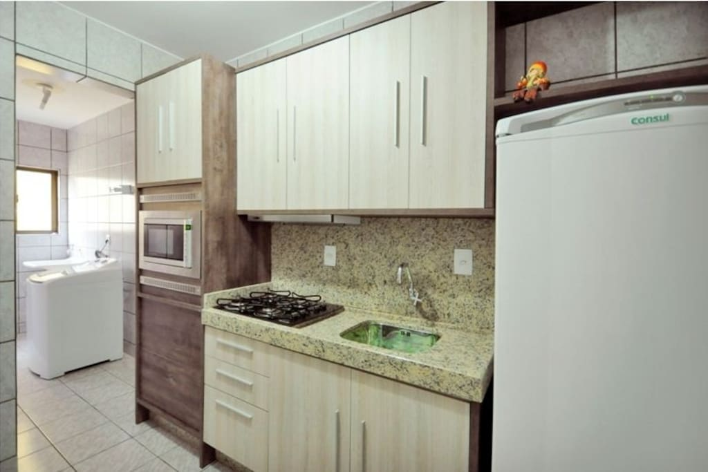 Complete kitchen , with micro-wave, mixer, coffee machine, stove and refrigerator.. And nice OVEN.