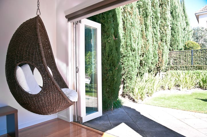 Admire the garden from the swing chair, or just kick back and read a book.