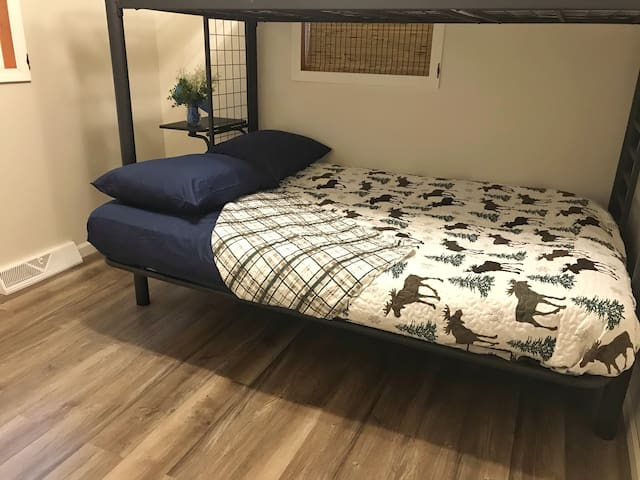 Bedroom 2 has a bunk bed setup with double bed on bottom and single on top for children.