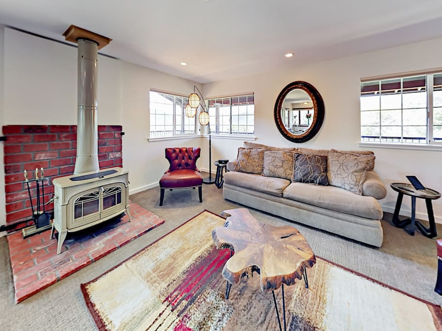 Unwind on a queen-size sleeper sofa and 2 leather chairs in the living room. (Please note the fireplace is not operational)