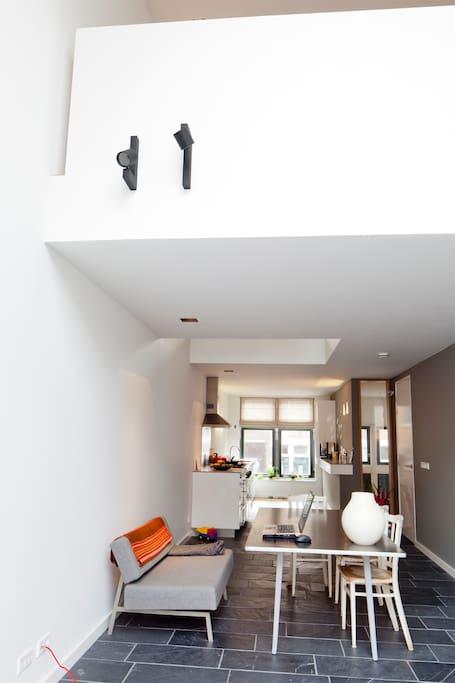Double height windows provide ample daylight on kitchenfloor.