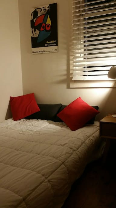 Double  bed in compact room