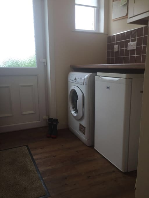Utility room with washing machine and extra fridge