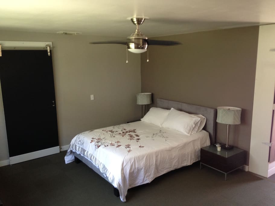 Queen bed and outlets next to bed; ceiling fan for cool breeze