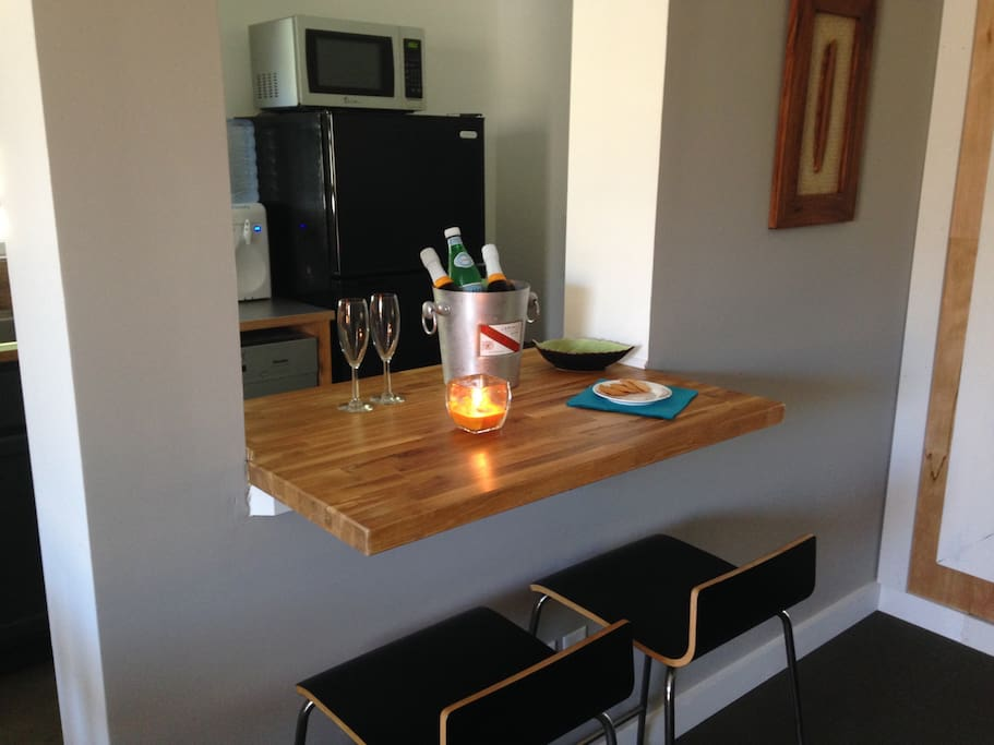 Breakfast bar with outlets to enjoy coffee or work