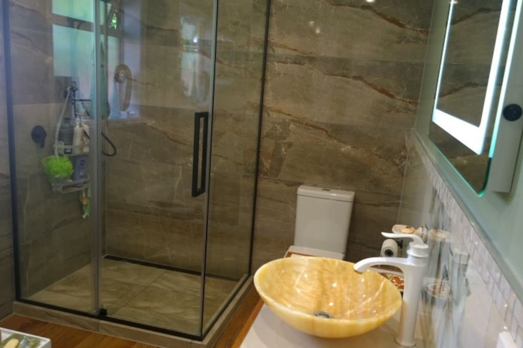 There is a large shower in the main shared bathroom