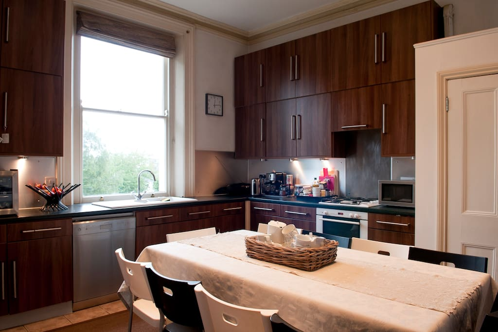 The kitchen contains an ample table, that when extended, sits up to ten people.