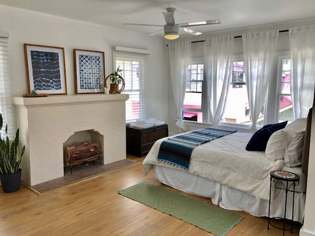 light and bright bedroom with ceiling fan and lots of window to enjoy those ocean breezes