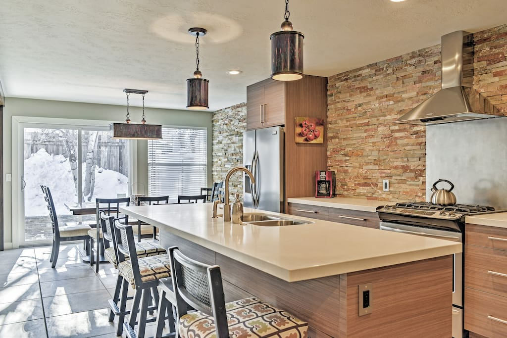 You'll love preparing a meal in this fully renovated kitchen with brand new white quartz countertops.