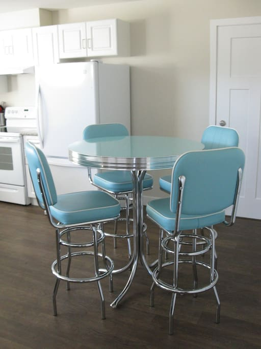 A modern take on a 50s fad:  a pedestal aborite table and bar stools from Anmarcos Furniture.