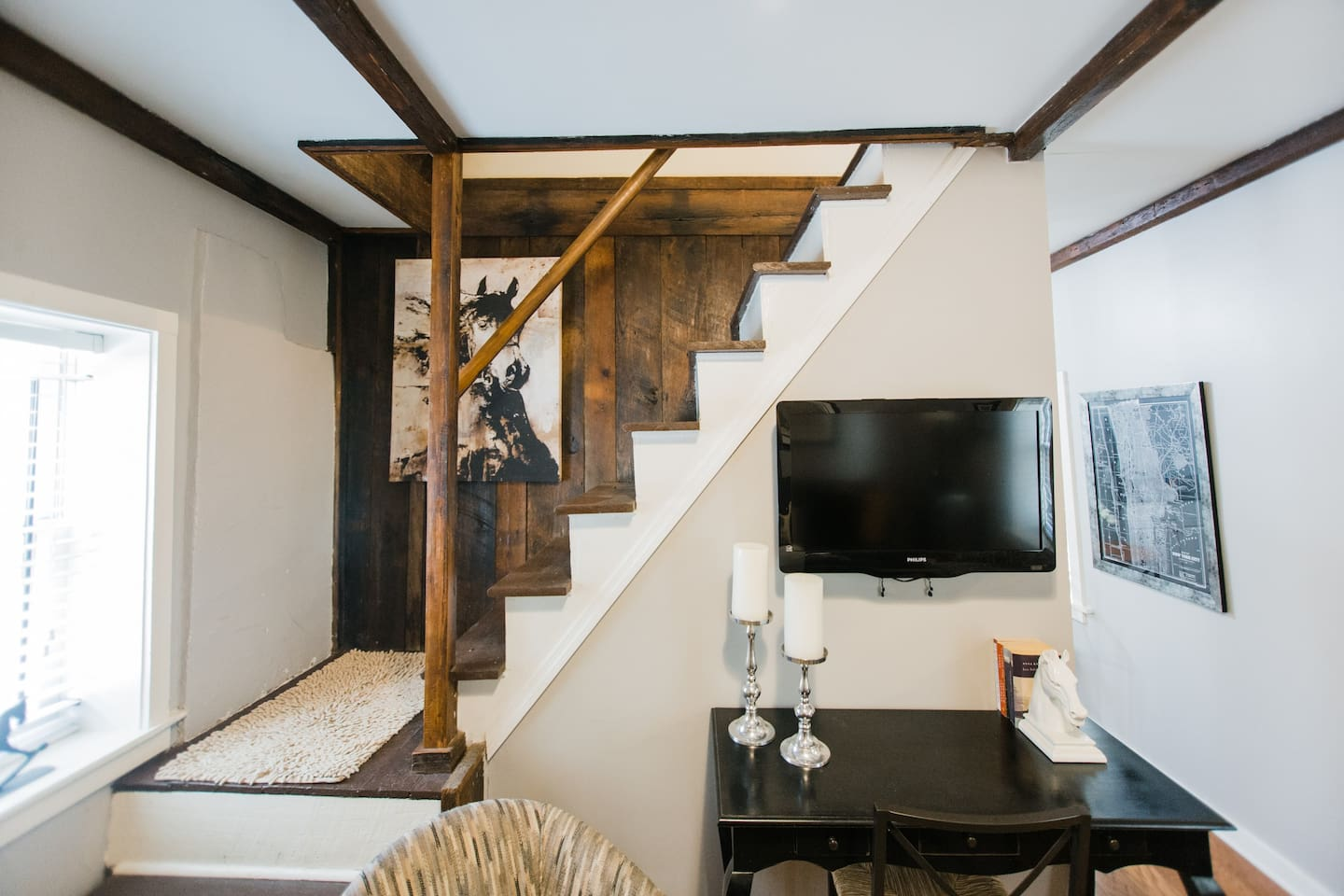 Exposed beams and rough-hewn paneling are remnants of a bygone and historic era when the carriage house was just that, a house for the carriage and the fine folks who cared for the horse drawn type and then the horse powered type.