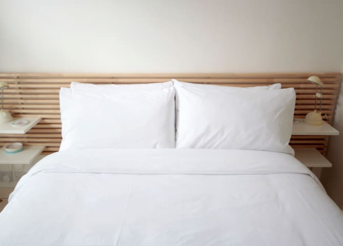 Cuddle up with new high thread-count sheets and a selection of  hypo-allergenic pillows.  Towels also provided.