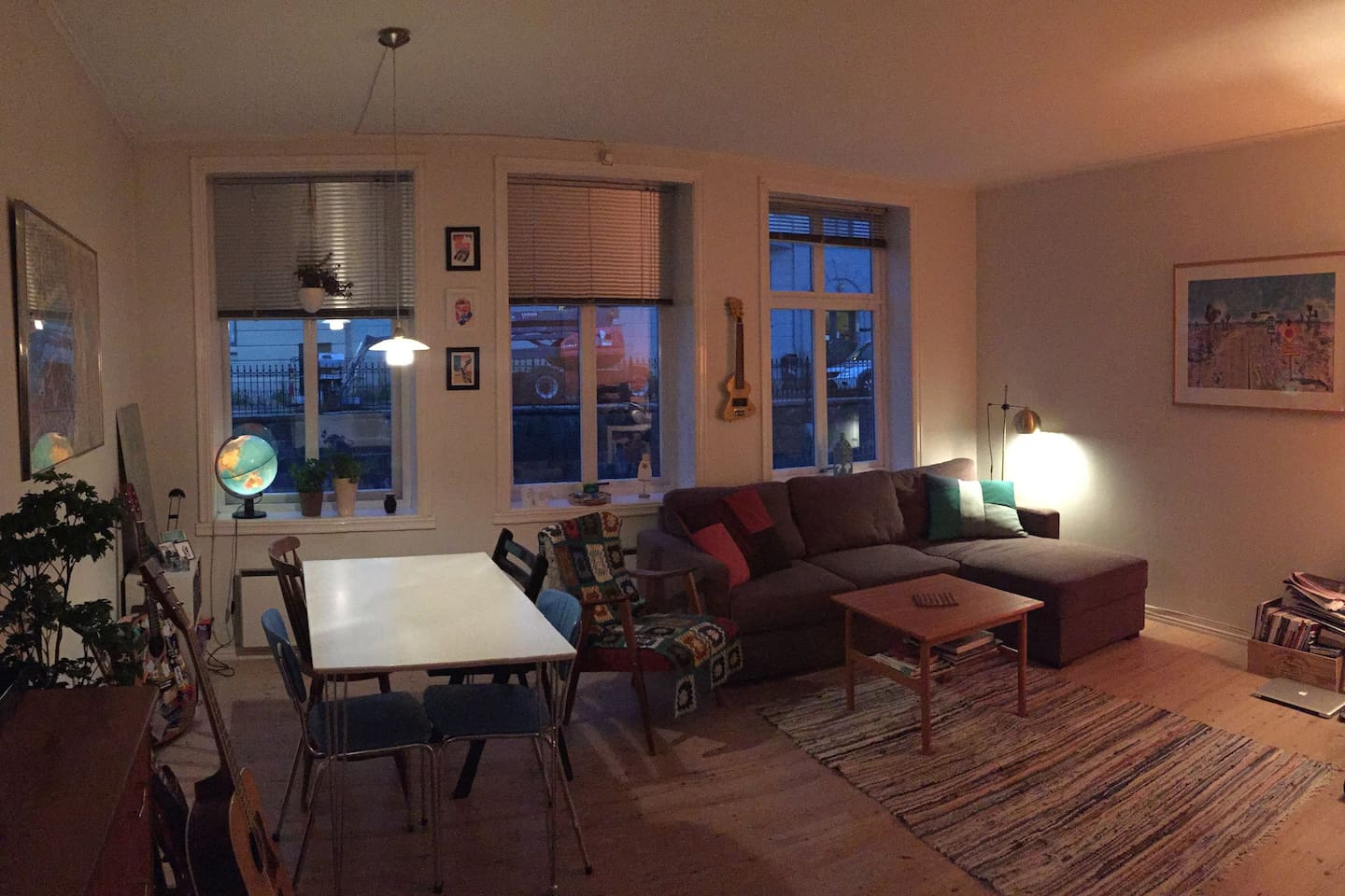 Spacious living room with sofa bed and dining table