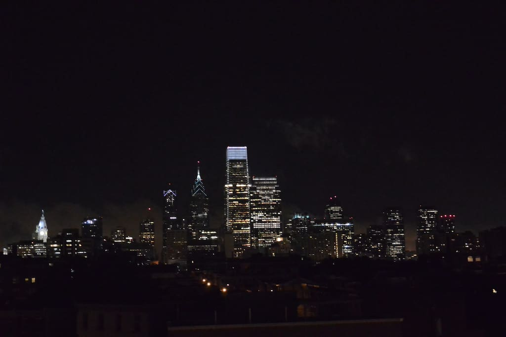 Night time viewing of center city skyline from the  roof deck