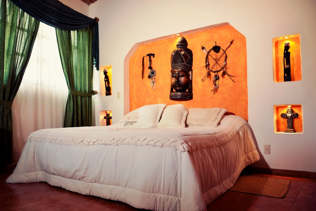 Our traditional suite with a king  size bed and an incredible view to our garden.